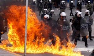 Greece  strikes: A petrol bomb explodes near riot police in Athens